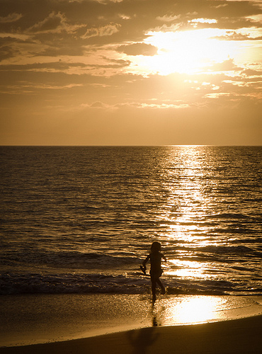 Young Girl Running On Beach at Sunset, Maui Hawaii