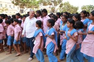 Achyuta Samanta along with the children of  Kalinga Institute of Social Sciences