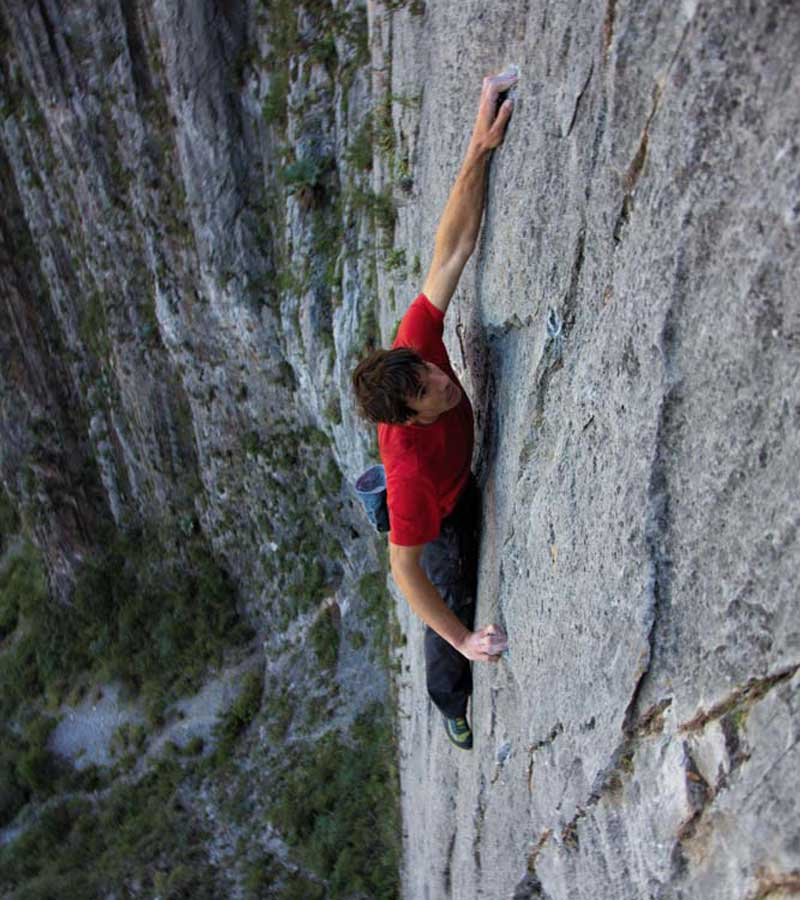 Alex Honnold on the Rock Face,  El Sendero Luminoso. Do not try this without training and safety measures